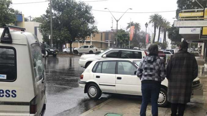 Car mounts footpath in busy Grafton CBD spot