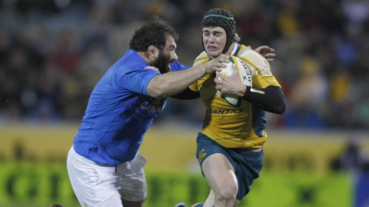 12. Berrick Barnes makes a break. The Australian Wallabies played the Italian rugby team at the Canberra Stadium.