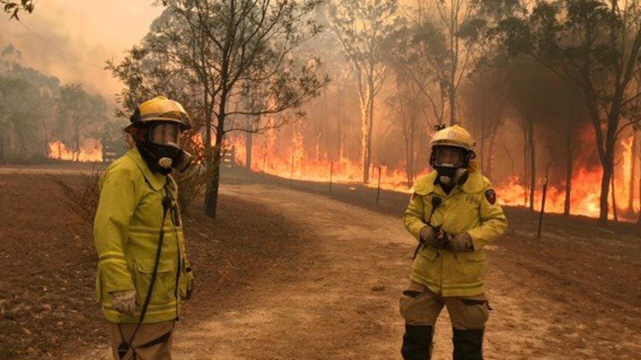 Fire fighters battle a blaze in Central Queensland in December last year.