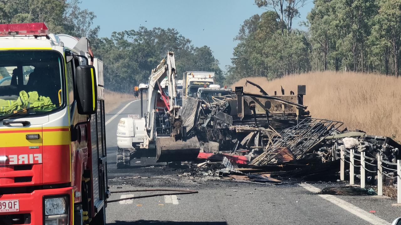 The charred remains of a semi trailer sitting on the Bruce Highway, 37km south of Miriam Vale, after a two truck crash on August 5, at 11.15pm. Picture Rodney Stevens