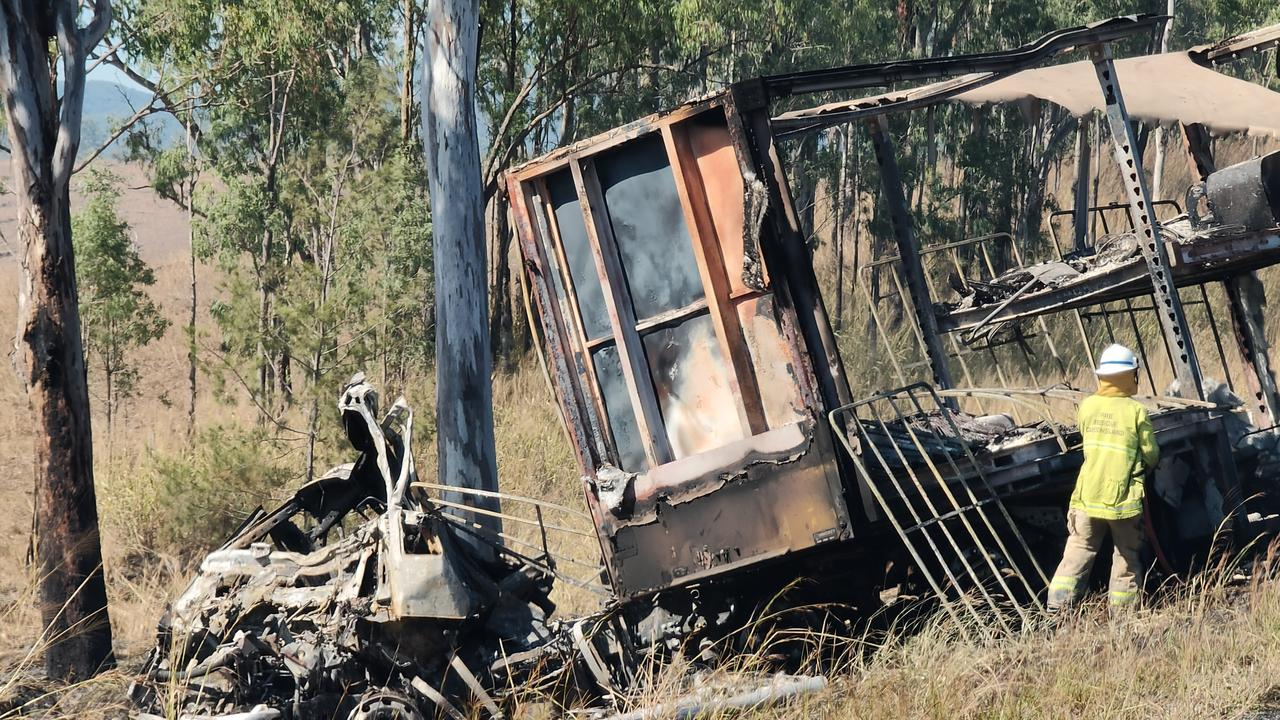 The charred remains of a semi trailer from which the driver was pulled to safety as it burned following a two truck crash on the Bruce Highway, 37km south of Miriam Vale, on August 5. Picture: Rodney Stevens