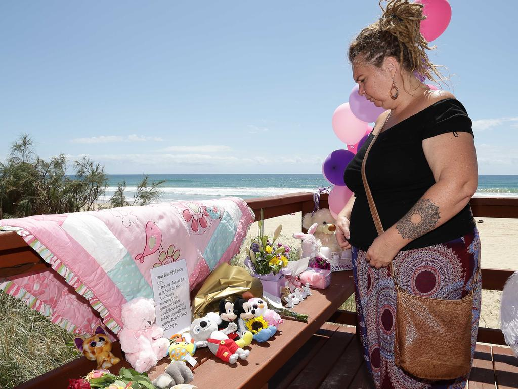 Jodie Devere of the Gold Coast pays tribute to the baby that was found dead on the beach in Surfers Paradise near Staghorn Ave. Photo: Tertius Pickard