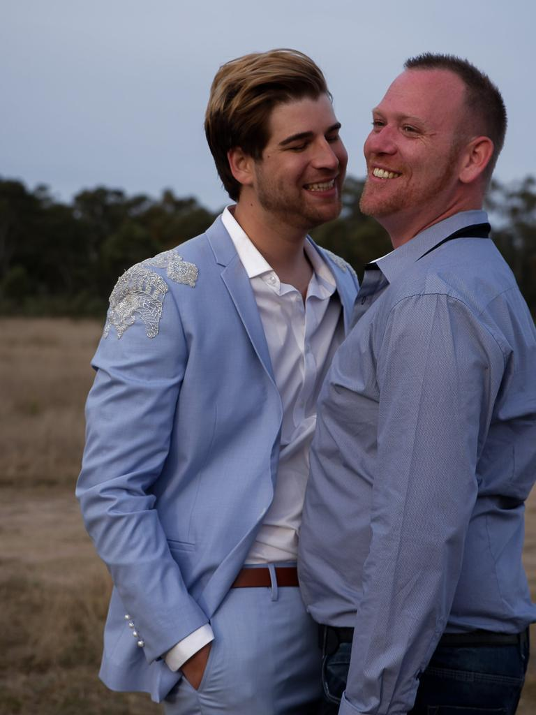 Eric Hofmeister and Luke Murray embracing after tying the knot at Leslie Dam.