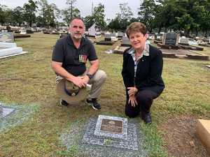 Julie Arthur and David Geck at the grave of their