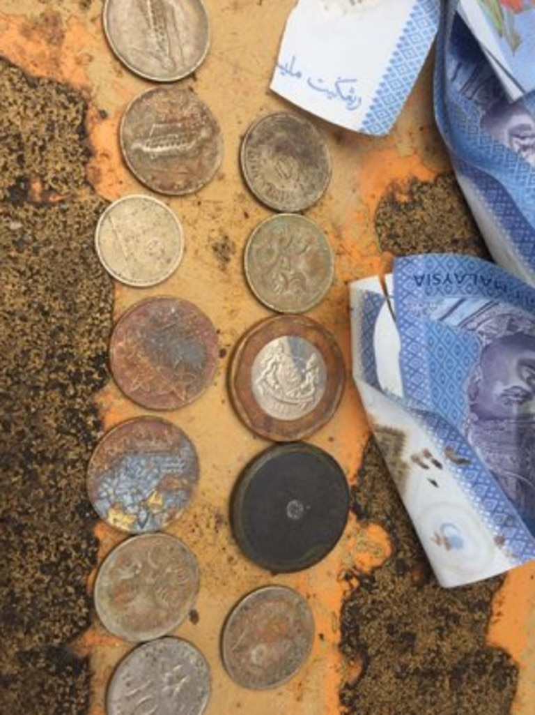 Australian and Malaysian money was found among the items on a Penang construction site. Picture: Supplied
