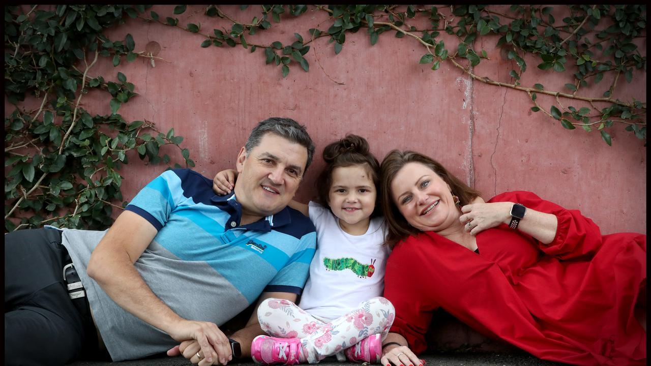Ava Pearce, 4, with her parents Amanda and Damien Pearce. Picture: Jamie Hanson