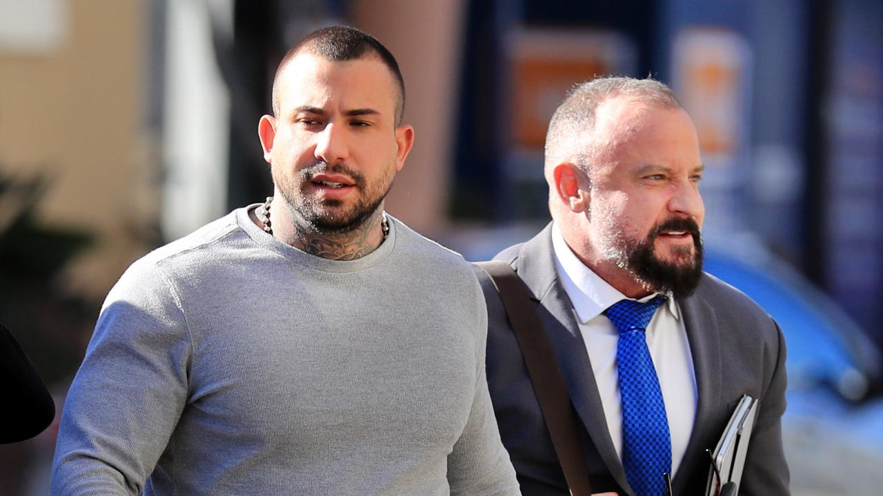 Defence Solicitor Campbell McCallum (right) with Harley Barbaro at Southport courthouse. Picture: Scott Powick