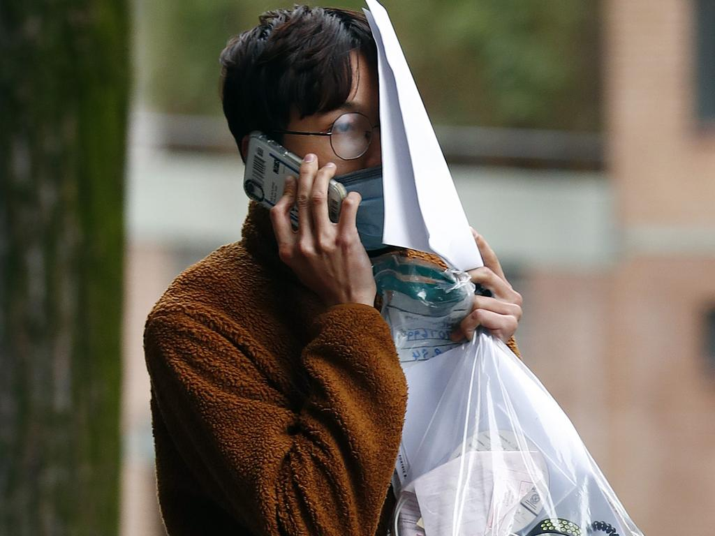 Trung Bao Le leaves Surry Hills Police Station after being charged with stealing $50k worth of handbags. Picture: Sam Ruttyn