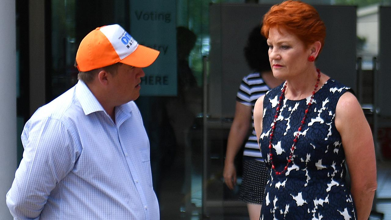One Nation Leader Senator Pauline Hanson (right) speaks with candidate Neil Symes (left) (AAP Image/Mick Tsikas)
