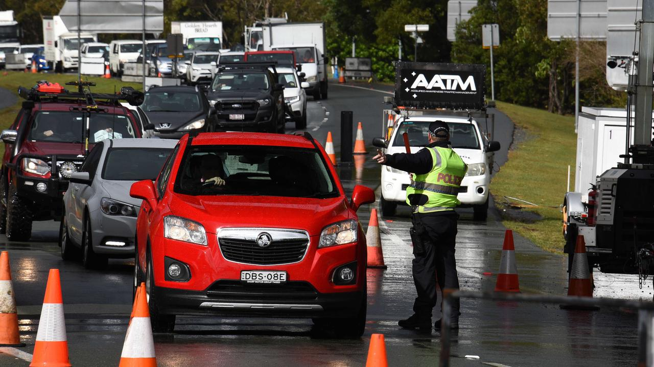 Police check cars at the Queensland border with NSW ahead of the border closure. Picture: NCA NewsWire / Steve Holland