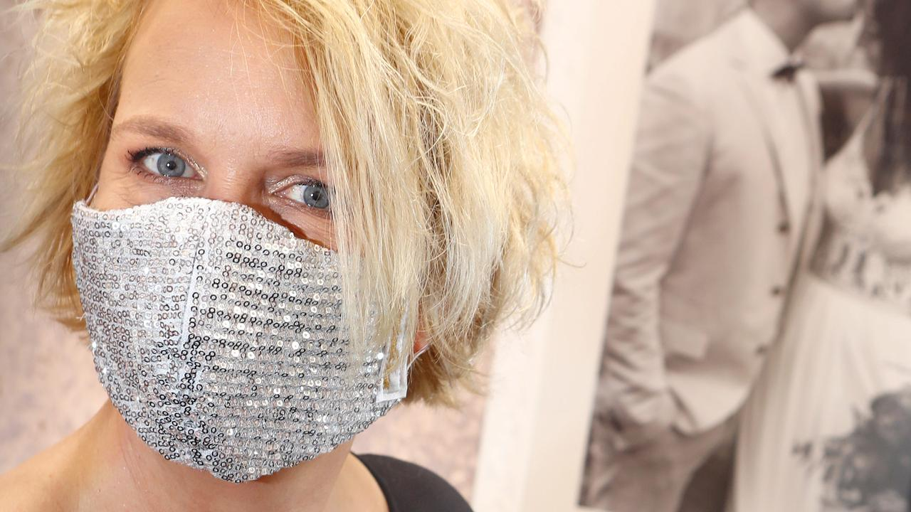 Material once used for high-end  weddings dresses is being repurposed to create face masks, in a business shift that has saved a dressmaker from near collapse.