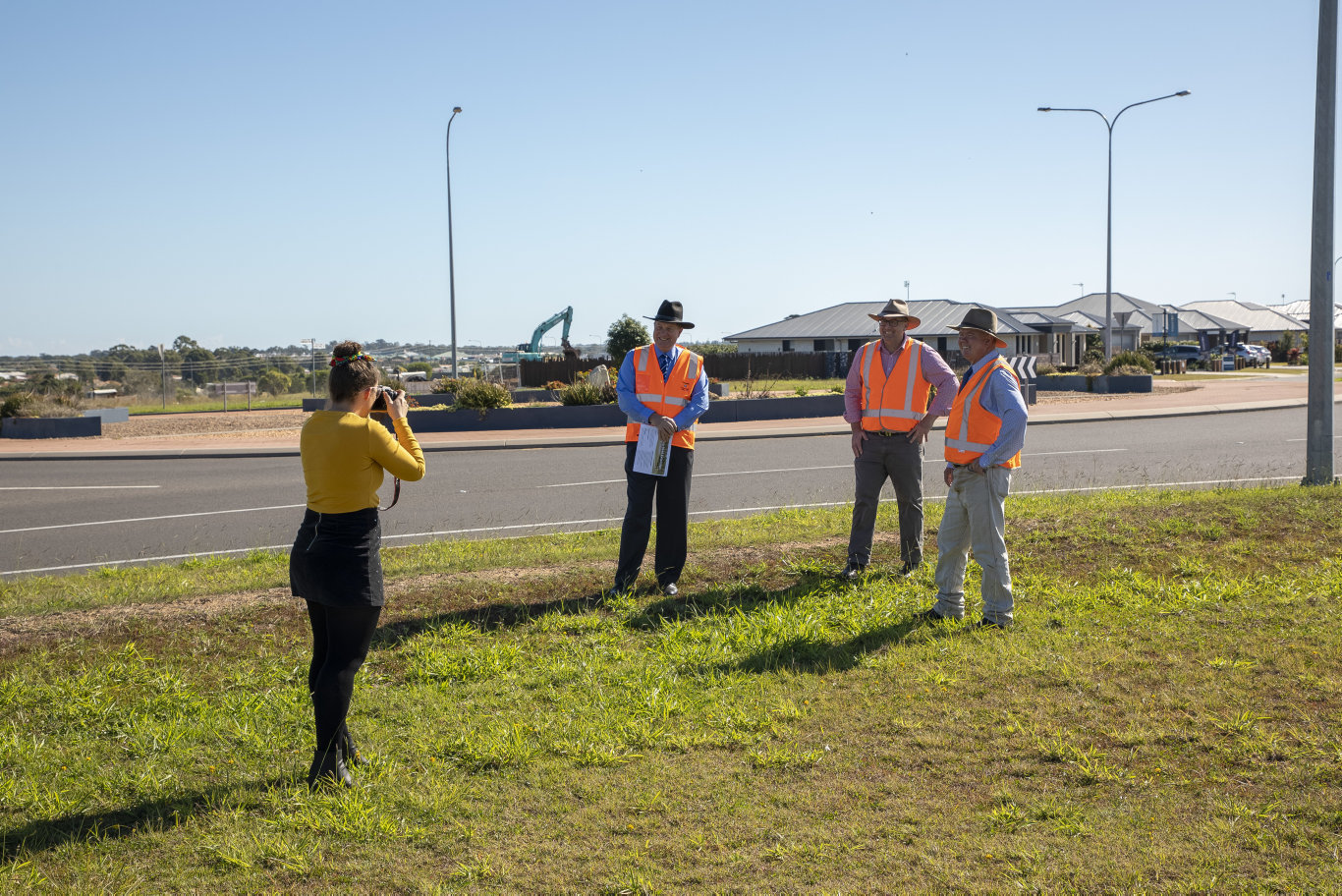 Chronicle journalist Jessica Cook covering a story on a long-awaited road upgrade.