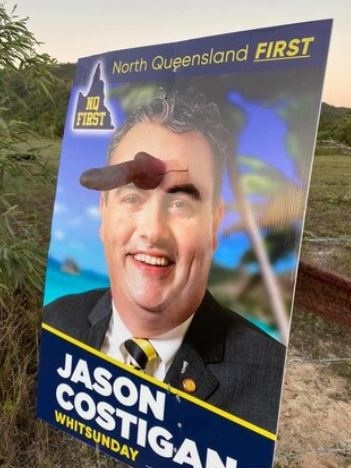 A creative critic has defaced one of MP Jason Costigan's campaign signs with a dildo.