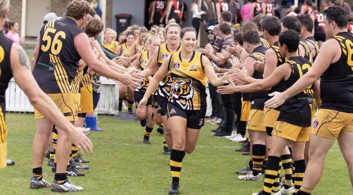 Tweed Tigers captain Rachel Kelly played her 50th game for the club on Saturday. Pictured leading her team out onto the field at an earlier game. Pic: Supplied.