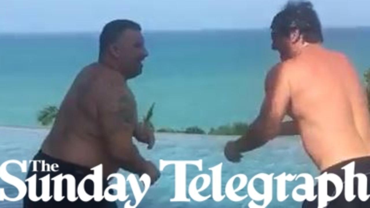 Michael Ibrahim and Mim Salvato wrestle on the poolside