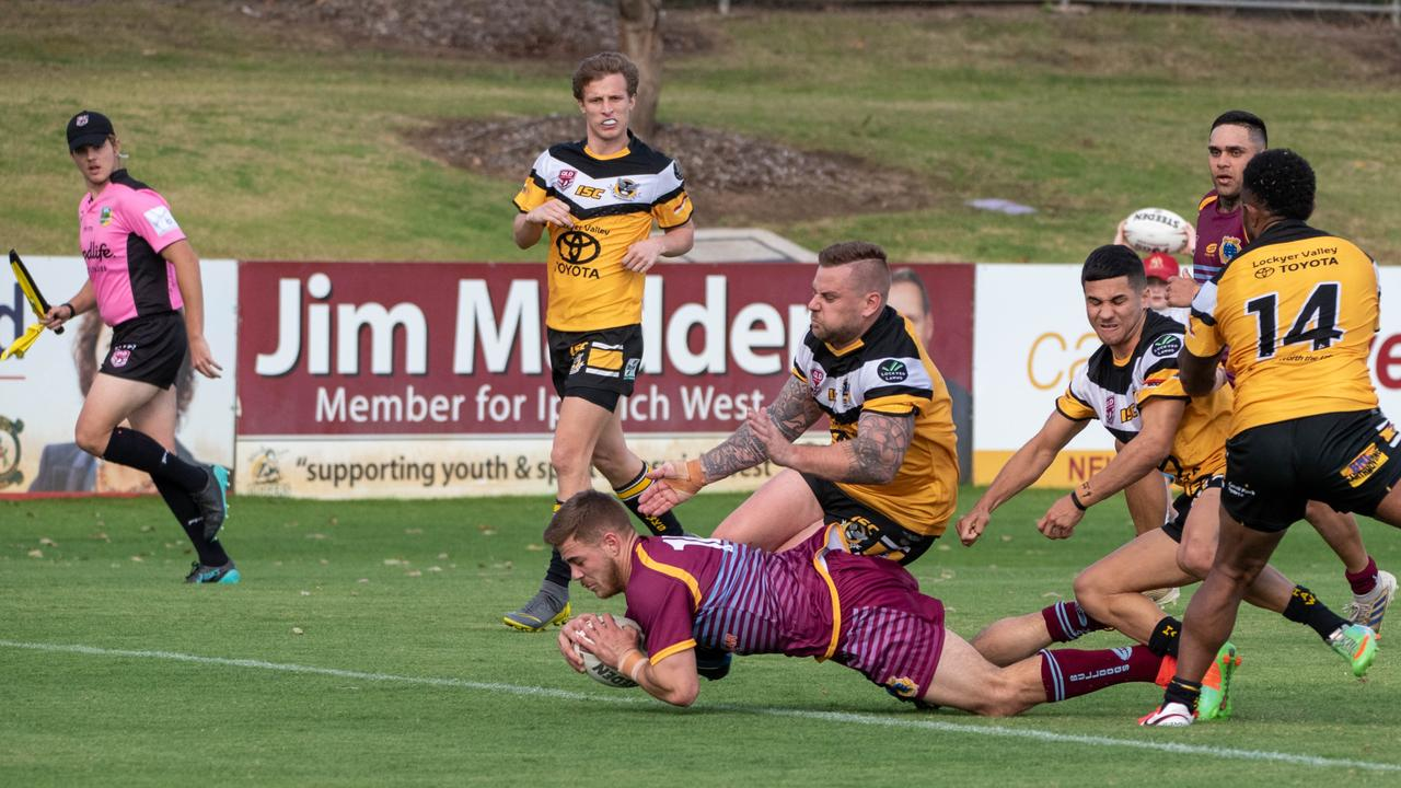 West End half Jesse Zampech dives over to score one of his two tries in the Bulldogs' 36-30 round 2 Volunteers Cup win over Gatton. Picture: Bruce Clayton