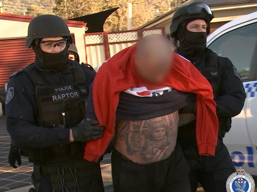 Strike Force Raptor officers arrest a man during a raid in Sackville in Sydney's north. Picture: NSW Police