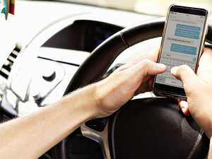 Drivers in a fine mess over mobile phone use