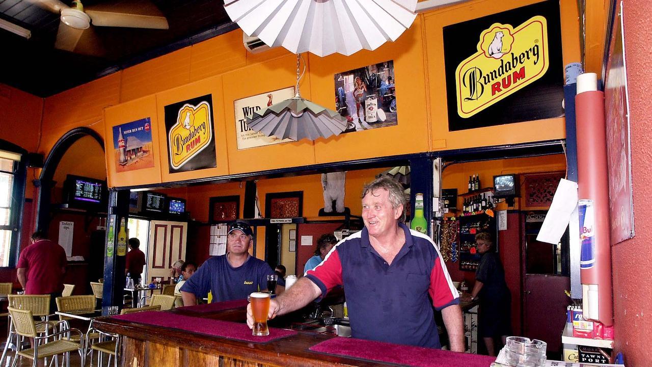 Grand Hotel Childers owner Dennis Corliss serves up a beer.