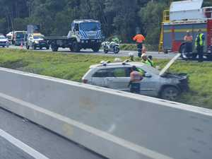 Bruce Highway traffic nightmare after car rolls into ditch