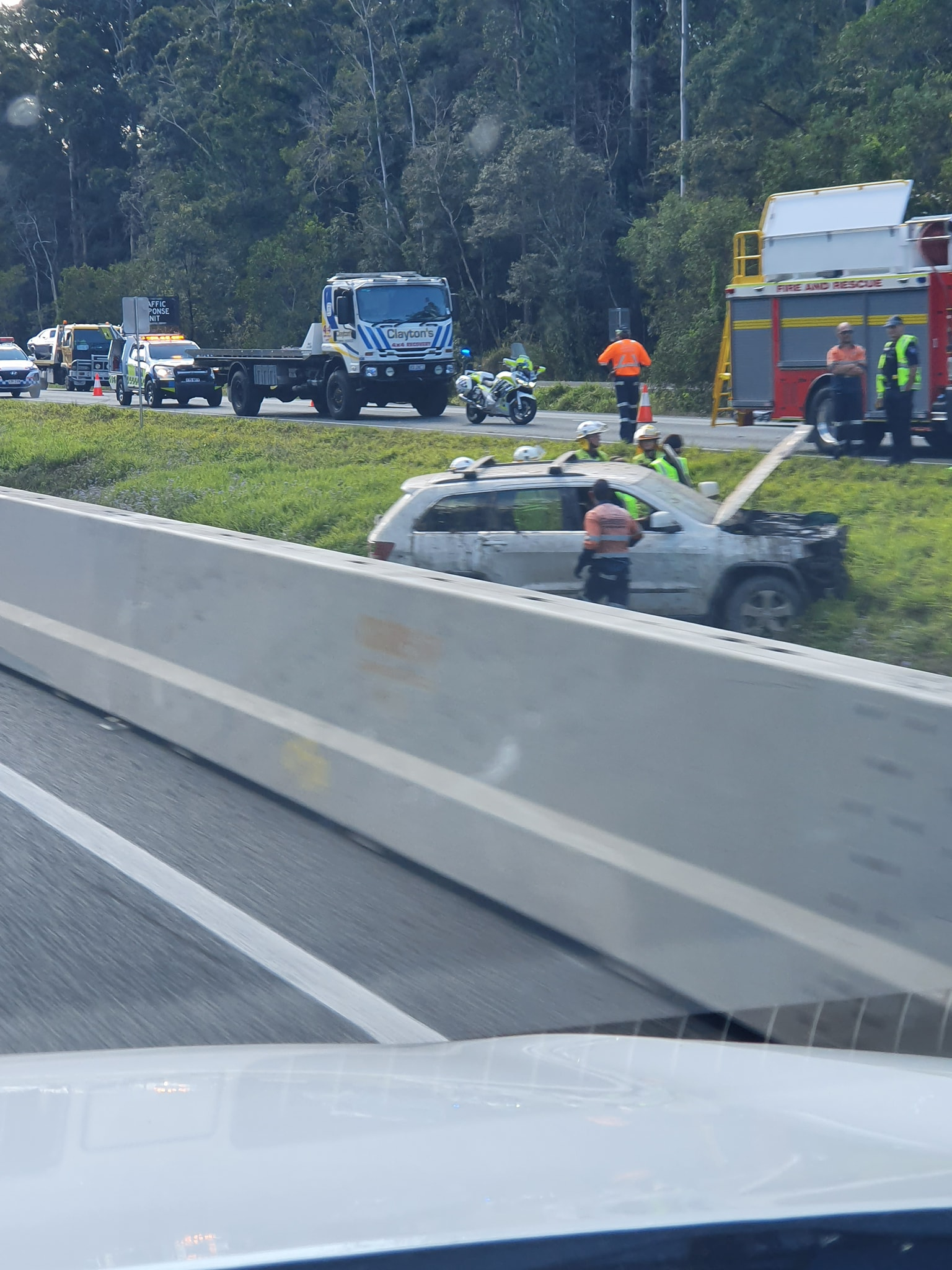 Two people have been injured after a car and truck crash on the Bruce Highway. Photo: Adrian Fogarty