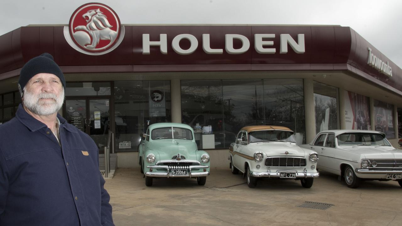 Holden car club owners display their cars at Toowoomba Holden prior to Holden signage being removed
