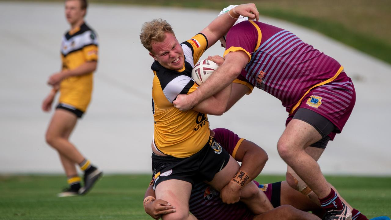 Gatton Hawks' Joel Bret gets wrapped by West End, with Oliver Bichel in the background, in round two of the Volunteers Cup. PHOTO: Bruce Clayton