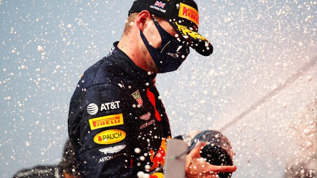A refreshing shower for Max Verstappen.