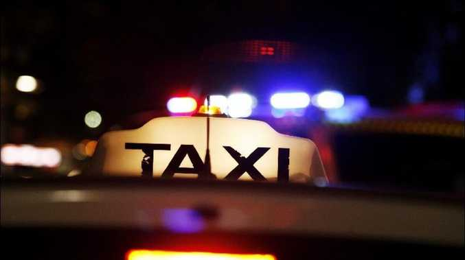 Man allegedly dived head first into taxi's front passenger seat