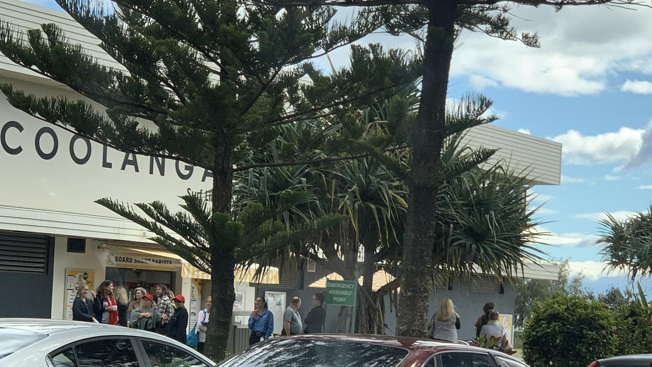 People being evacuated from The Strand at Coolangatta.