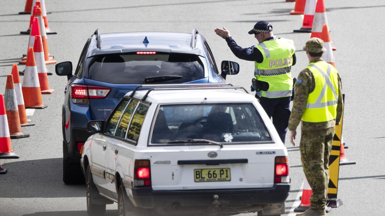 The Premier has hinted that there is a chance of a hard border lockdown if NSW cases head north beyond Newcastle. Police and army at the Queensland border. Picture: NIGEL HALLETT