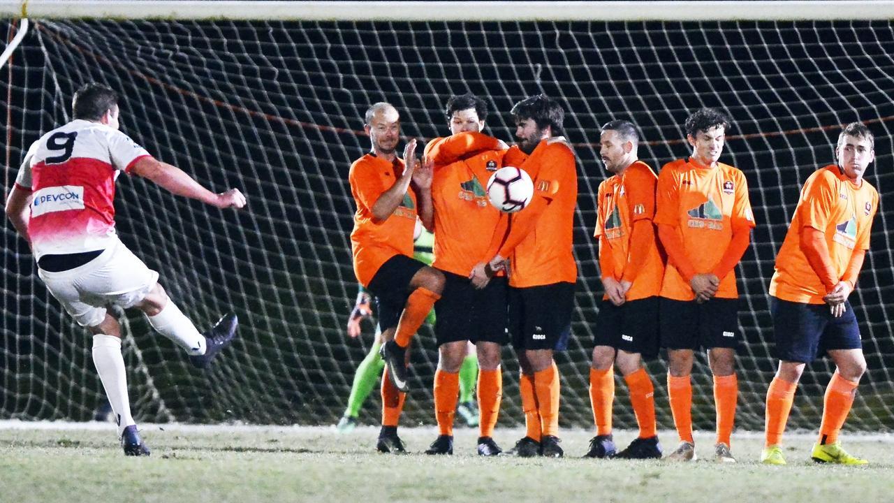 Caloundra's Ethan Galbraith kicks for goal.