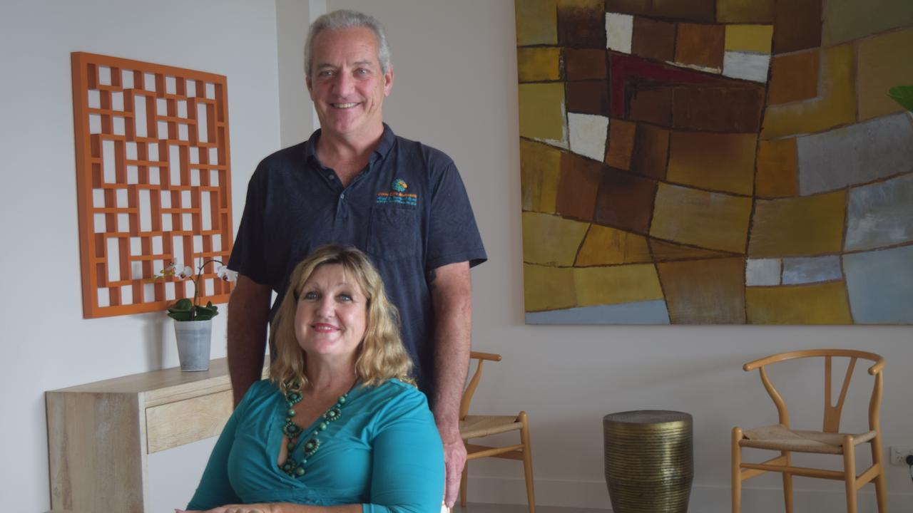 Coral Cove Apartments managers Patrick Riordan and Kate Lindsay are staying positive despite challenges posed by coronavirus. Photo: Laura Thomas