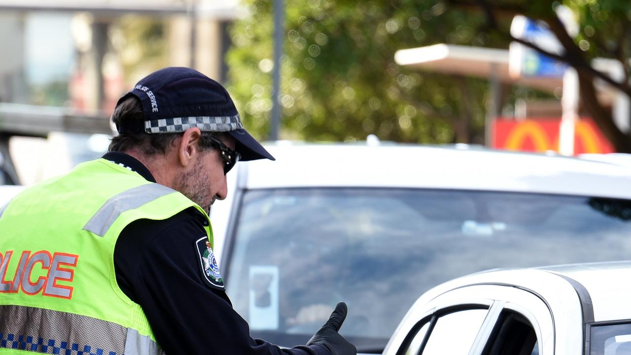 Police check cars at the Queensland border with NSW at Griffith Street at Coolangatta after the border closed the NSW. Picture: NCA NewsWire / Steve Holland