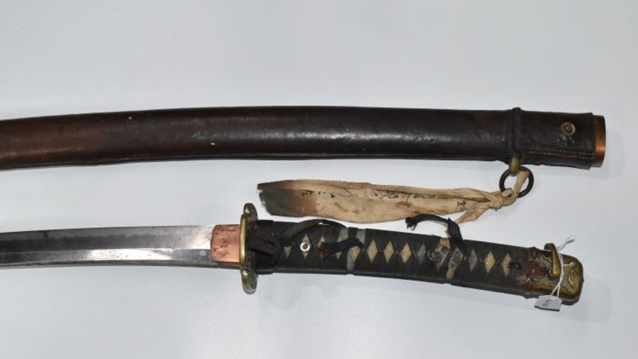 This is not the alleged weapon used, it is an example of a Japanese military Samurai sword World War II issue. Supplied