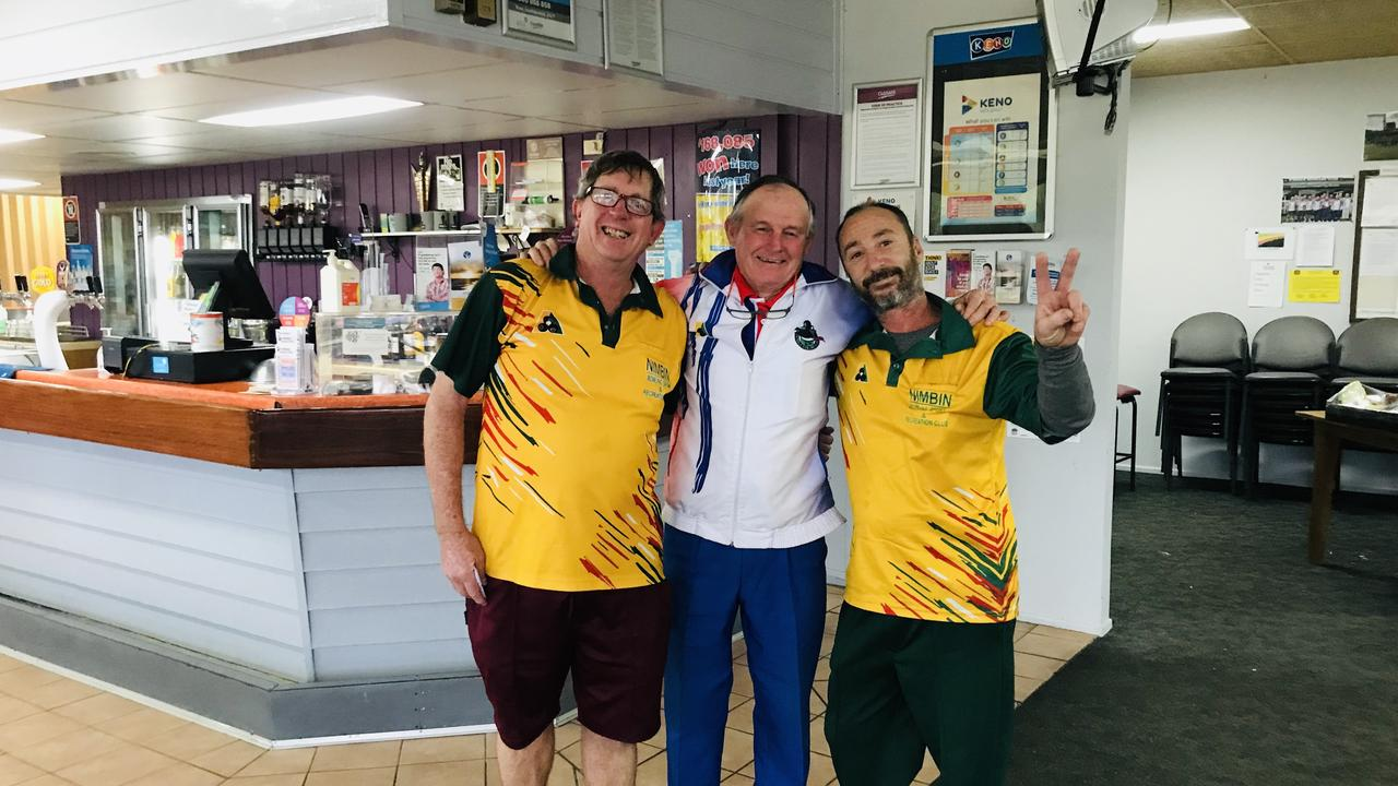 KYOGLE'S KINGS OF THE GREEN: The annual bowls carnival was a great success at Kyogle, president Doug Petherbridge presents the Friday men's pairs winners, N Brocklbank and G Harrison from Nimbin with the prize money.