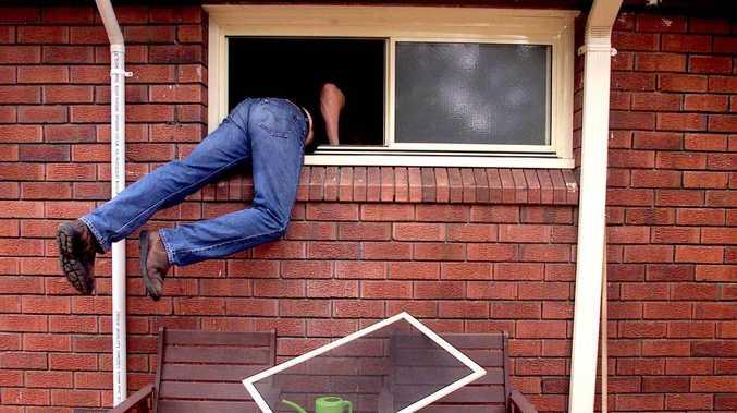 Resident confronts burglar searching through kitchen