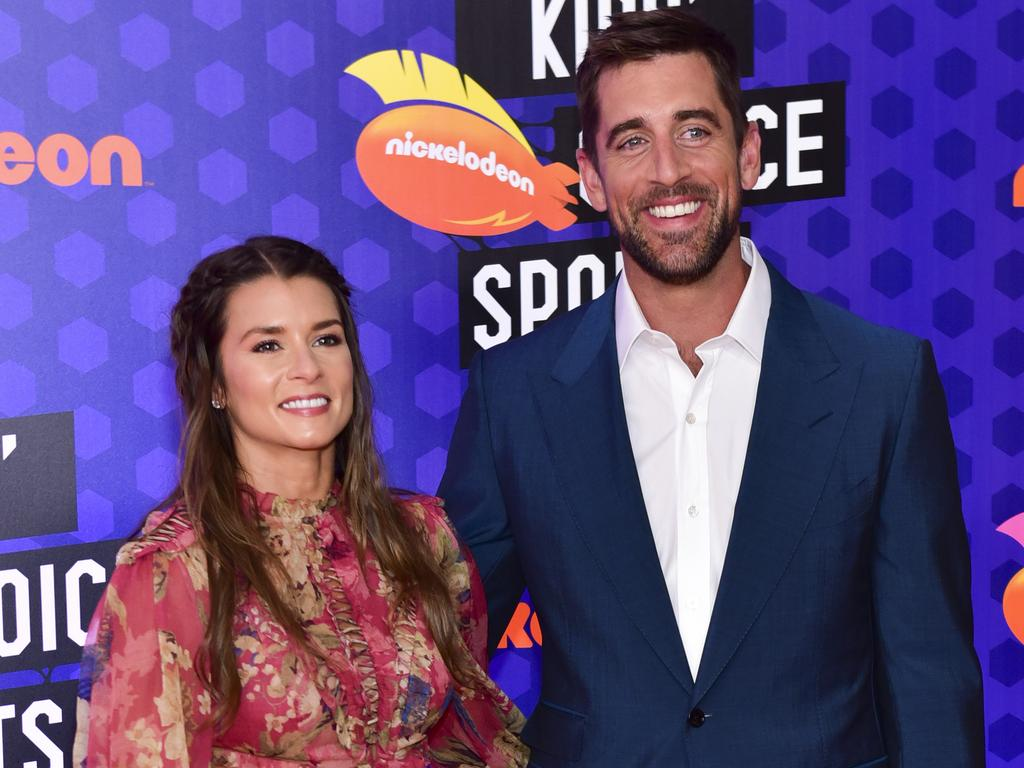Race car driver Danica Patrick and quarterback Aaron Rodgers in 2018.