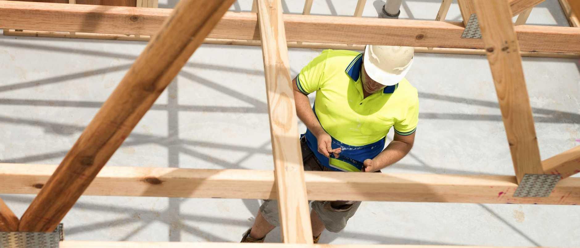 Builder checking plan on digital tablet