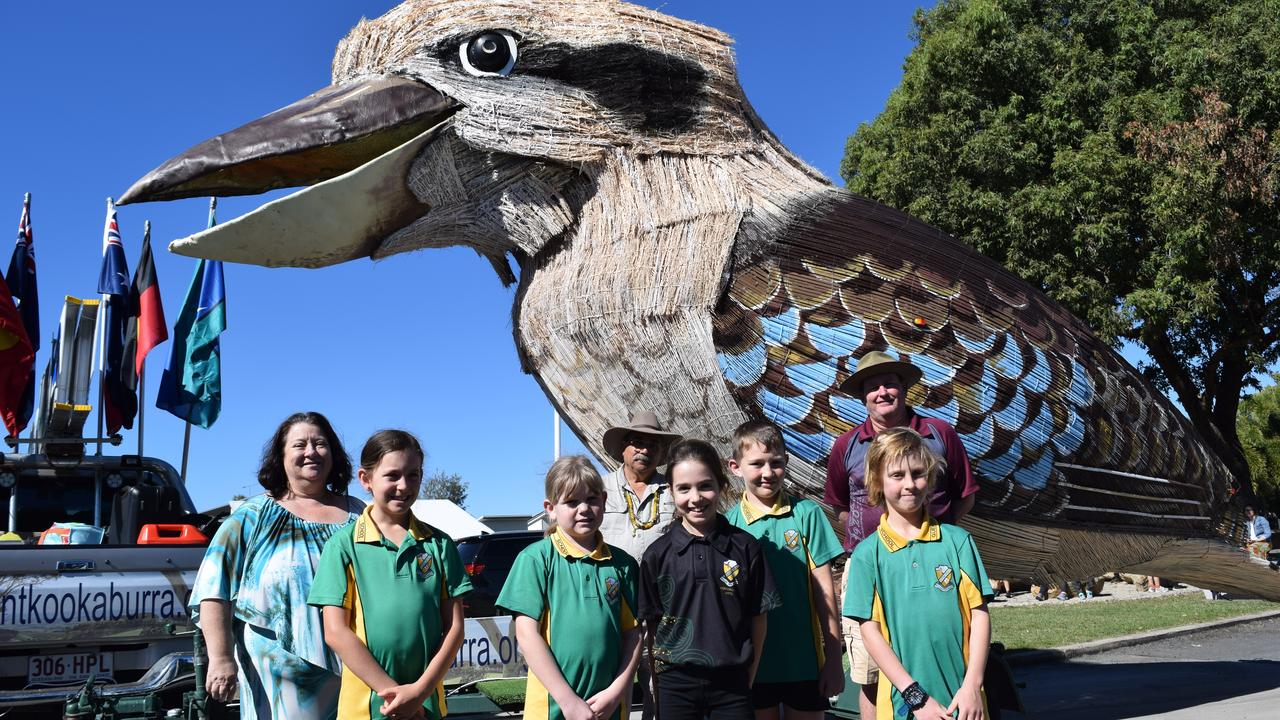 (Back, from left) Queens Beach State School principal Tammy Dimech, Giant Kookaburra creator Dr Farvardin Daliri, Queens Beach State School deputy principal David Insch, (front) Year 3 students Sammy Vincent, 9, Zaykira Smith, 8, Isla Gullo, 9, Dallas Hudson, 8, and Cooper Murray, 9, with the Giant Laughing Kookaburra. Photo: Elyse Wurm