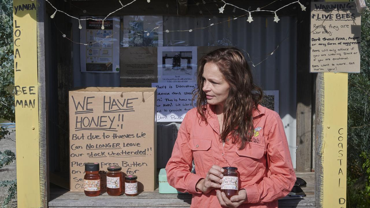 Tammy Gardner stands with her Raw Bee Co roadside stall that has been getting robbed over the past three weeks. Photo: Adam Hourigan