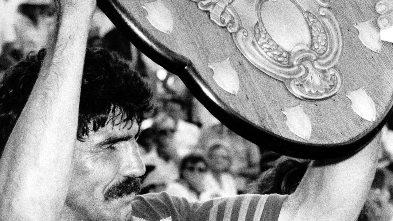 Captain-coach Rod Reddy holds aloft the Winfield Shield.