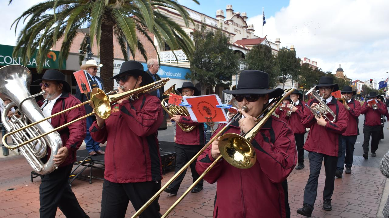 BREAK FROM TRADITION: coronavirus has meant The Warwick City Band has had to change their traditional performance style. Note: photo taken before social distancing. Photo File