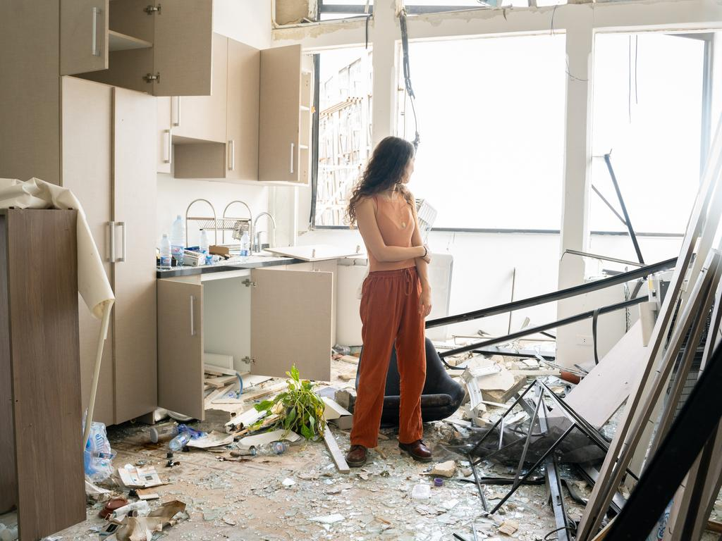 Karen, aged 25, stands in her destroyed apartment in Gemmayze neighbourhood, Beirut. Picture: Manu Ferneini/Getty Images