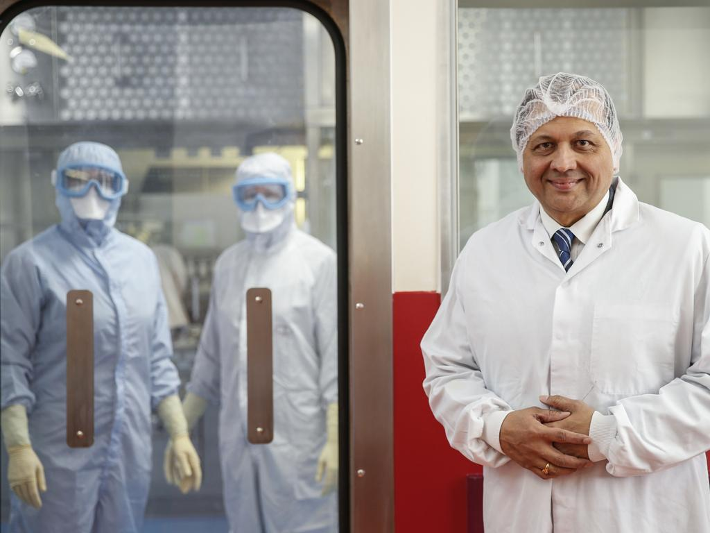Ravi Limaye, managing director of Wockhardt UK, pictured with manufacturing workers at their production line in Wrexham, North Wales. Picture: Hollie Adams