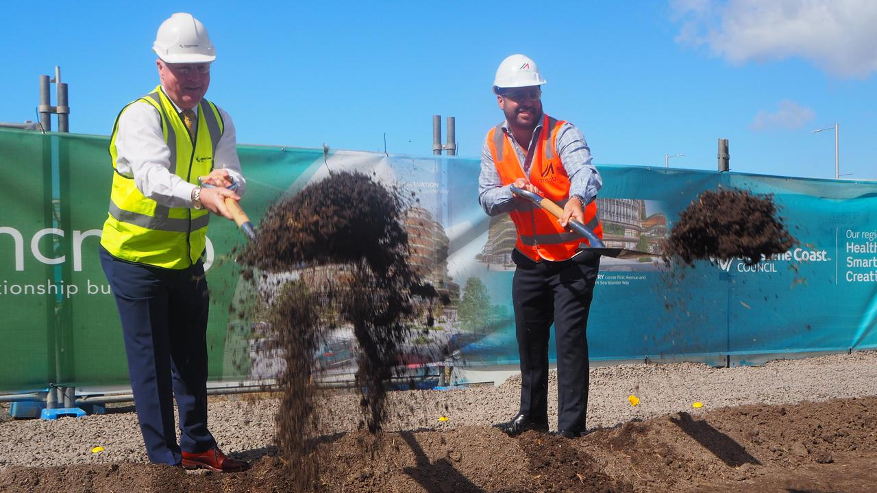 Sunshine Coast Mayor Mark Jamieson and McNab Sunshine Coast construction manager Carl Nancarrow turn the first sod for the new city hall at the Maroochydore City Centre.