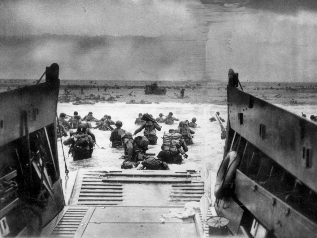 Soldiers wade to the beach during the D-Day landing at Normandy, France. Picture: Time-LIFE