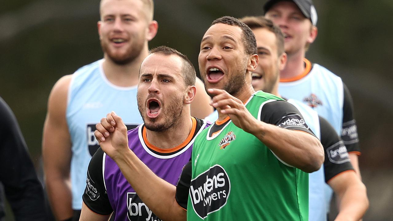 Josh Reynolds and Moses Mbye at Wests Tigers training this week. Picture: Phil Hillyard