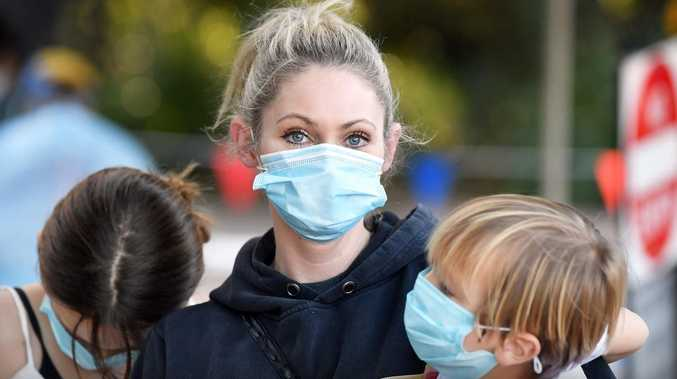 'I hope it's the flu': Mum takes kids for COVID test