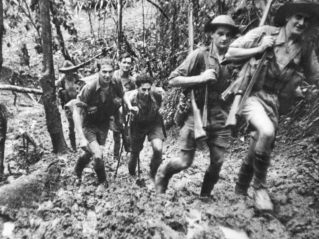 Members of Australia's D Company, 39th Battalion, return to their base camp after a battle at Isurava on the Kokoda Track. Picture: Damien Parer